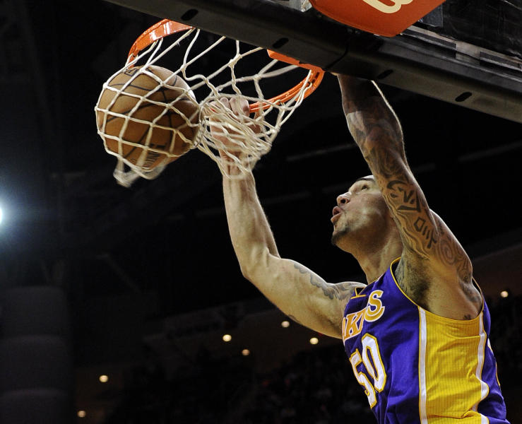 Los Angeles Lakers' Robert Sacre dunks the ball against the Houston Rockets in the first half of an NBA basketball game Tuesday, Jan. 8, 2013, in Houston. (AP Photo/Pat Sullivan)