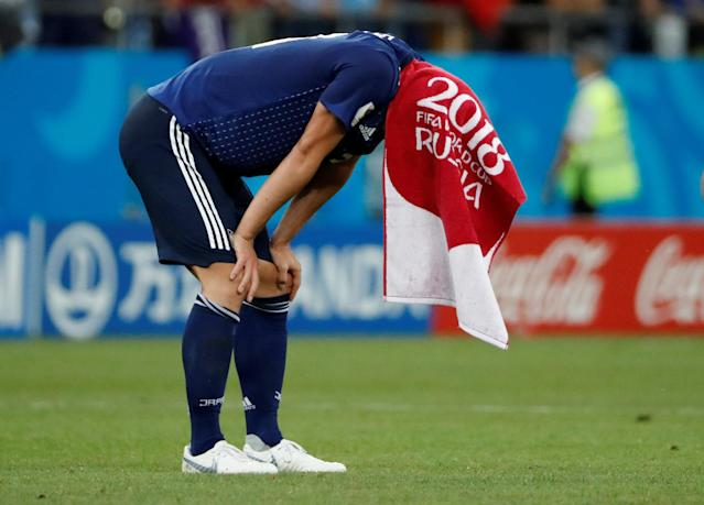 <p>Japan's Gen Shoji looks dejected after the match REUTERS/Jorge Silva </p>