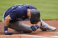 Seattle Mariners' Mitch Haniger lays on the field after getting hit by a pitch in the first inning of a baseball game against the Cleveland Indians, Sunday, June 13, 2021, in Cleveland. Haniger left the game after the incident. (AP Photo/Tony Dejak)