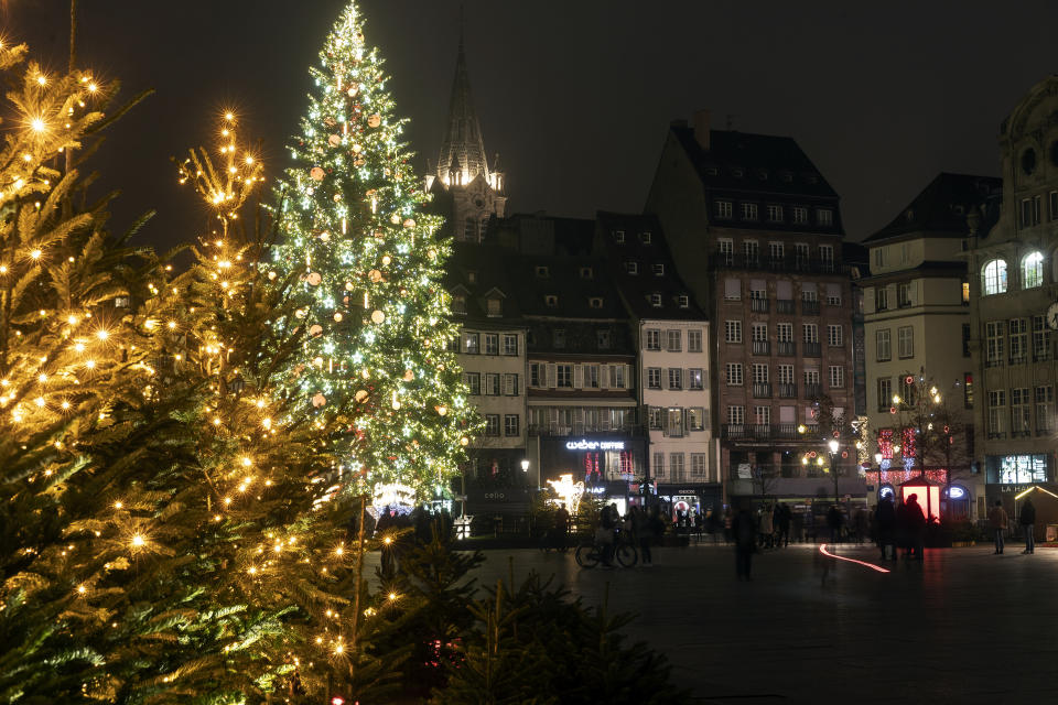 Christmas lightings are pictured where the Christmas market usually takes place, Friday, Nov.27, 2020 in Strasbourg, eastern France. Due to the COVID-19 pandemic, the well-known festive market will not be taking place this year. (AP Photo/Jean-Francois Badias)