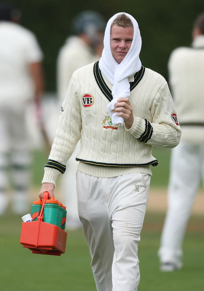 WELLINGTON, NEW ZEALAND - MARCH 22:  Steven Smith of Australia walks from the field after a drinks break during day four of the First Test match between New Zealand and Australia at Westpac Stadium on March 22, 2010 in Wellington, New Zealand.  (Photo by Marty Melville/Getty Images)