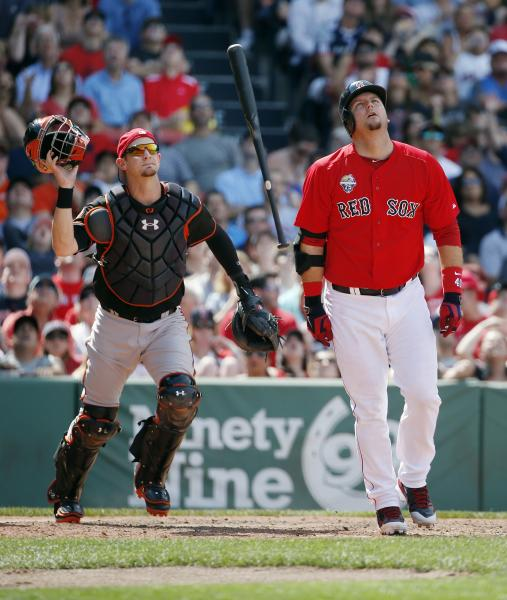 Boston Red Sox's A.J. Pierzynski, right, reacts to his pop out in front of Baltimore Orioles' Caleb Joseph in the eighth inning of the first game of a baseball doubleheader in Boston, Saturday, July 5, 2014. (AP Photo/Michael Dwyer)