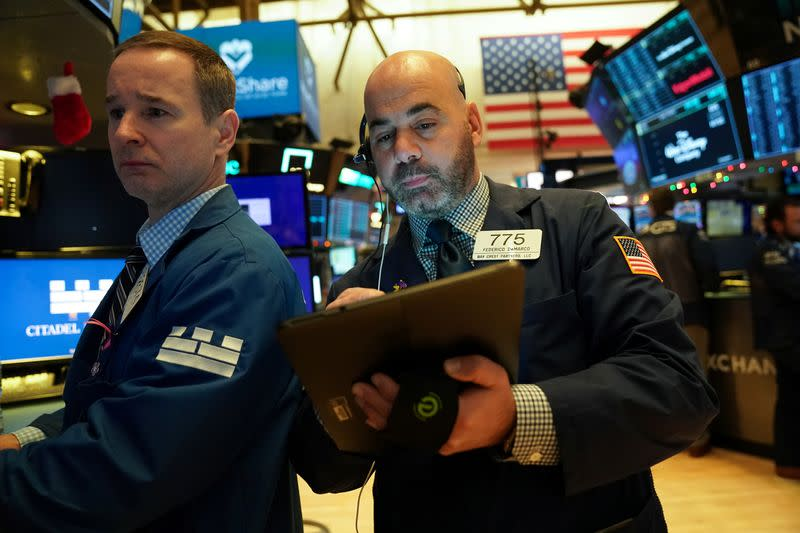 Global shares gain in record year-end rally, dollar slips