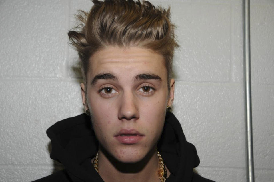 Canadian pop singer Justin Bieber is pictured in police custody in Miami Beach, Florida January 23, 2014 in this Miami Beach Police Department handout released to Reuters on March 4, 2014. Bieber was charged with driving under the influence, resisting arrest and using an expired license after Miami Beach police say they caught him drag racing on January 23. Bieber pleaded not guilty to the charges. REUTERS/Miami Beach Police Dept./Handout via Reuters (UNITED STATES - Tags: CRIME LAW ENTERTAINMENT) ATTENTION EDITORS – THIS IMAGE WAS PROVIDED BY A THIRD PARTY. FOR EDITORIAL USE ONLY. NOT FOR SALE FOR MARKETING OR ADVERTISING CAMPAIGNS. THIS PICTURE IS DISTRIBUTED EXACTLY AS RECEIVED BY REUTERS, AS A SERVICE TO CLIENTS