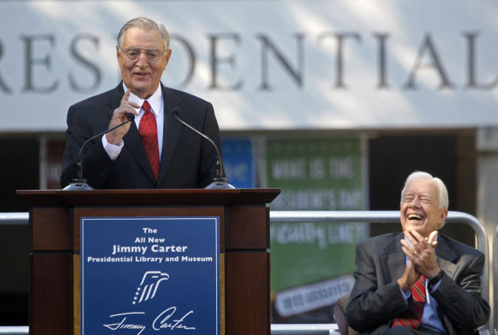 FILE - In this Thursday, Oct. 1, 2009, file photo, former President Jimmy Carter, right, laughs, as his former Vice President Walter Mondale speaks during a reopening ceremony for the newly resigned Carter Presidential Library in Atlanta. Carter was also celebrating his 85th birthday. Mondale, a liberal icon who lost the most lopsided presidential election after bluntly telling voters to expect a tax increase if he won, died Monday, April 19, 2021. He was 93. (AP Photo/John Bazemore, File)