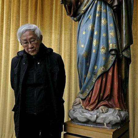 Former head of the Catholic Church in Hong Kong, Cardinal Joseph Zen, 86, poses at a news conference in Hong Kong, China February 9, 2018. REUTERS/Bobby Yip