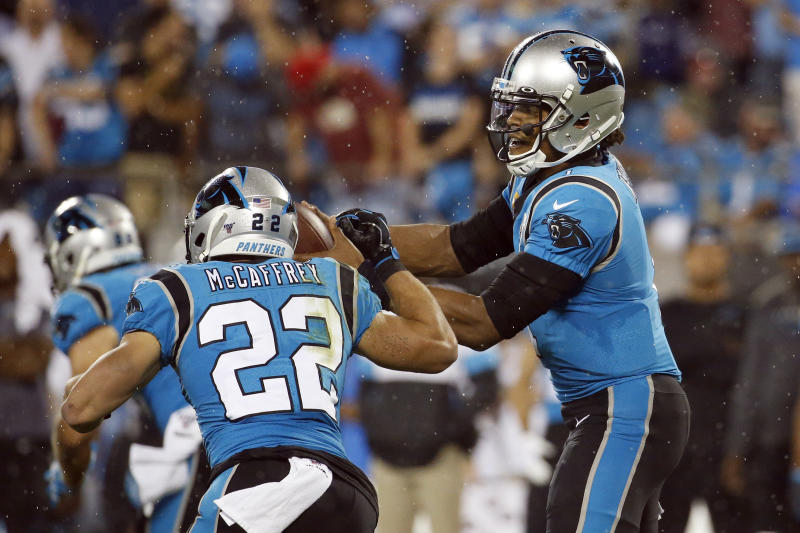 Carolina Panthers quarterback Cam Newton (1) hands off to running back Christian McCaffrey (22) during the first half of an NFL football game in Charlotte, N.C., Thursday, Sept. 12, 2019. (AP Photo/Brian Blanco)
