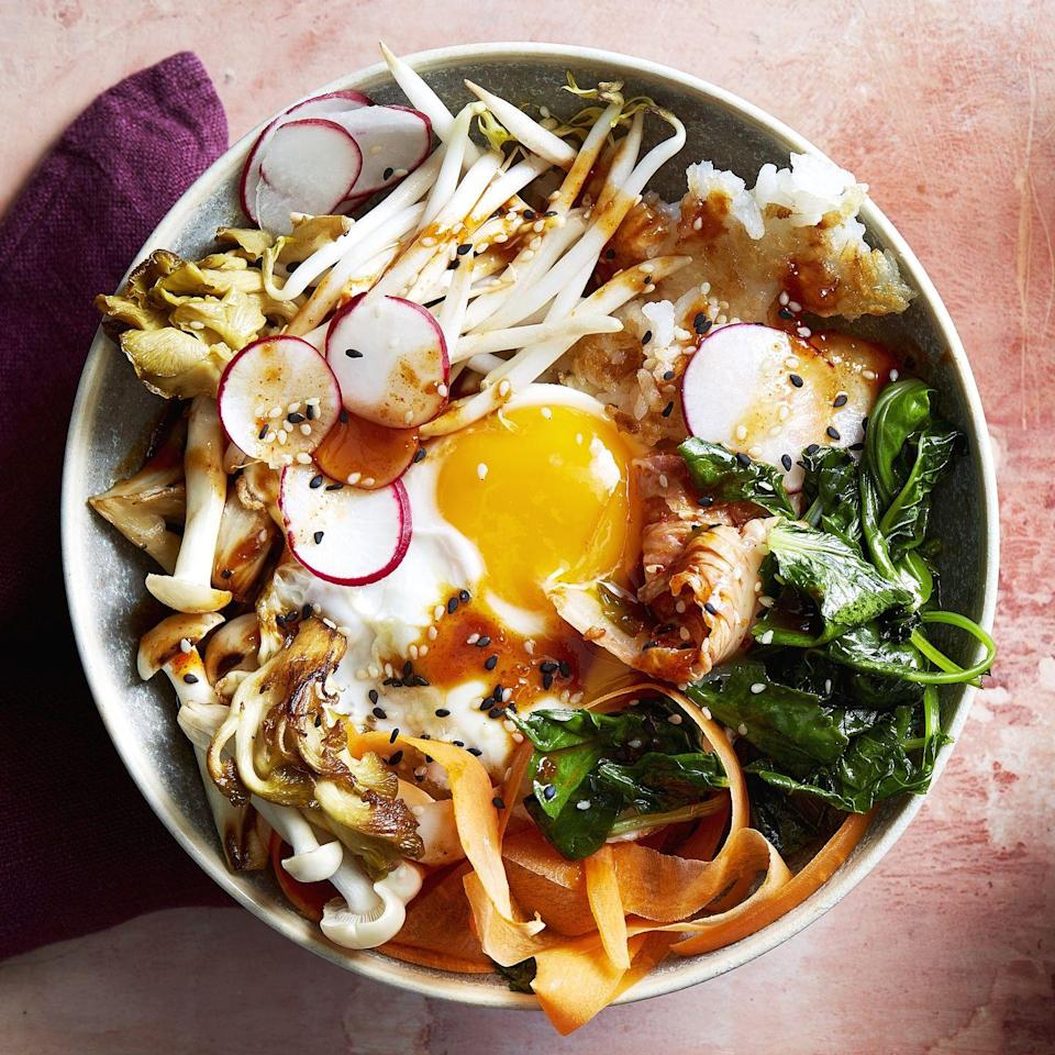"""<p>If you're struggling to find a use for those random veggies sitting at the back of the fridge, you're in luck: These bibimbap bowls play nice with just about any ingredients. They're both warm and spicy, thanks to tangy, <a href=""""https://www.prevention.com/food-nutrition/healthy-eating/a20890627/kombucha-benefits/"""" rel=""""nofollow noopener"""" target=""""_blank"""" data-ylk=""""slk:probiotic-rich"""" class=""""link rapid-noclick-resp"""">probiotic-rich</a> kimchi. Takeout has never tasted <em>this</em> good.</p><p><a href=""""https://www.prevention.com/food-nutrition/recipes/a33995647/korean-bibimbap-bowls-recipe/"""" rel=""""nofollow noopener"""" target=""""_blank"""" data-ylk=""""slk:Get the recipe »"""" class=""""link rapid-noclick-resp""""><strong><em>Get the recipe »</em></strong></a></p>"""