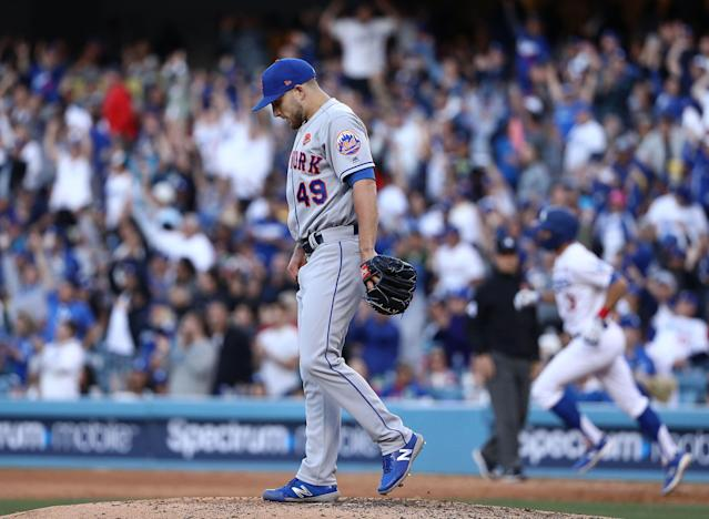 """LOS ANGELES, CALIFORNIA - MAY 27: Pitcher <a class=""""link rapid-noclick-resp"""" href=""""/mlb/players/11054/"""" data-ylk=""""slk:Tyler Bashlor"""">Tyler Bashlor</a> #49 of the <a class=""""link rapid-noclick-resp"""" href=""""/mlb/teams/ny-mets/"""" data-ylk=""""slk:New York Mets"""">New York Mets</a> looks on after giving up a solo homerun to Chris Taylor #3 of the <a class=""""link rapid-noclick-resp"""" href=""""/mlb/teams/la-dodgers/"""" data-ylk=""""slk:Los Angeles Dodgers"""">Los Angeles Dodgers</a> in the sixth inning of the MLB game at Dodger Stadium on May 27, 2019 in Los Angeles, California. (Photo by Victor Decolongon/Getty Images)"""