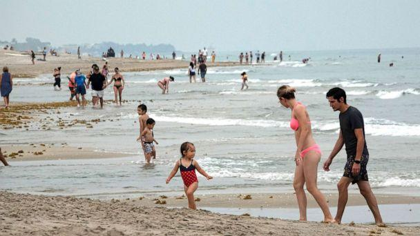 PHOTO: Social distancing rules are in effect in Delray Beach, Fla., as the beaches reopened, May 18, 2020, as part of the Palm Beach County Beach reopening. (Joe Cavaretta/South Florida Sun-Sentinel via AP)