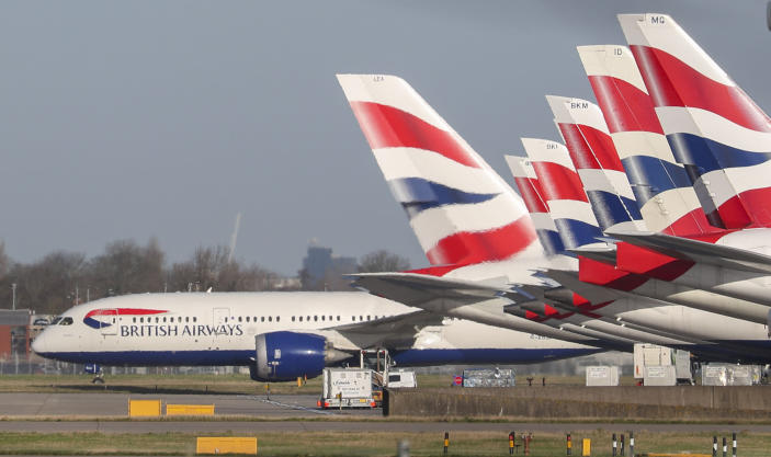 British Airways has said that it is pursuing cutbacks that could result in 12,000 job losses. (Steve Parsons/PA via AP)