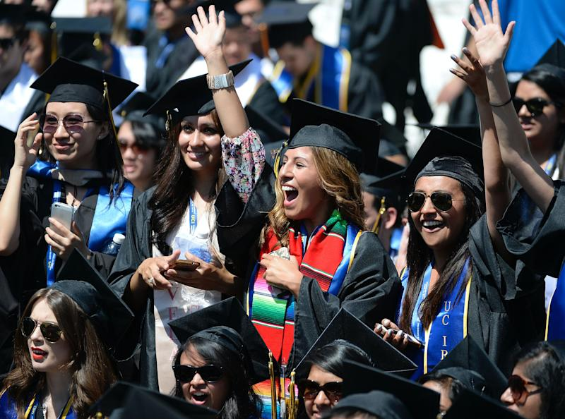 Graduating students wave to fellow students during the UC Irvine commencement ceremony at Angel Stadium of Anaheim June 14, 2014 in Anaheim, California. (Photo: Kevork Djansezian/Getty Images)