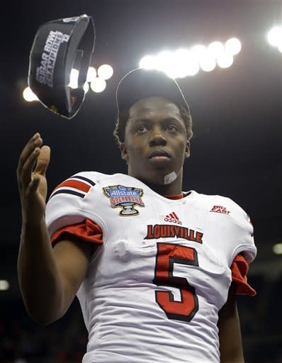 Louisville quarterback Teddy Bridgewater (5) flips his Sugar Bowl Championship hat into the air following a 33-23 win over Florida in the Sugar Bowl NCAA college football game Wednesday, Jan. 2, 2013, in New Orleans. (AP Photo/Bill Haber)