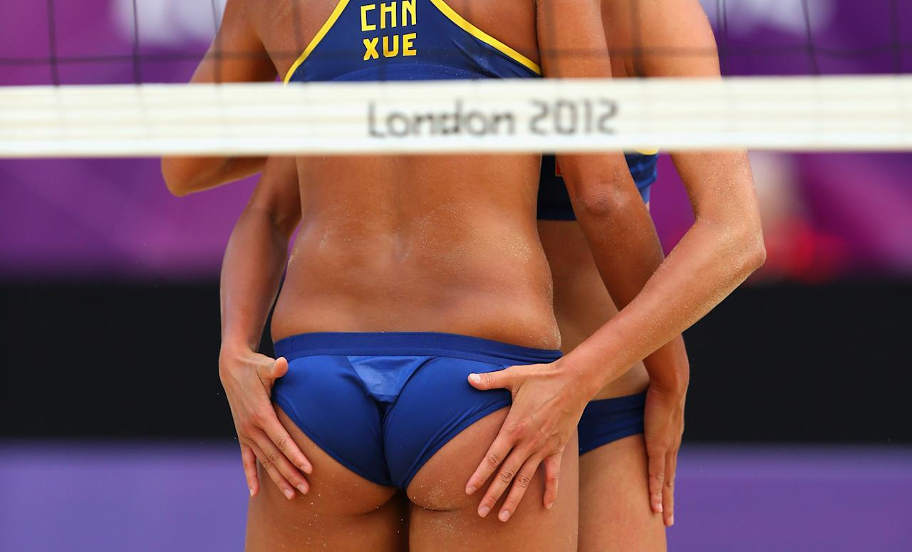 LONDON, ENGLAND - AUGUST 04:  Chen Xue of China and Xi Zhang of China celebrate during the Women's Beach Volleyball Round of 16 match between China and Russia on Day 8 of the London 2012 Olympic Games at Horse Guards Parade on August 4, 2012 in London, England.  (Photo by Ryan Pierse/Getty Images)