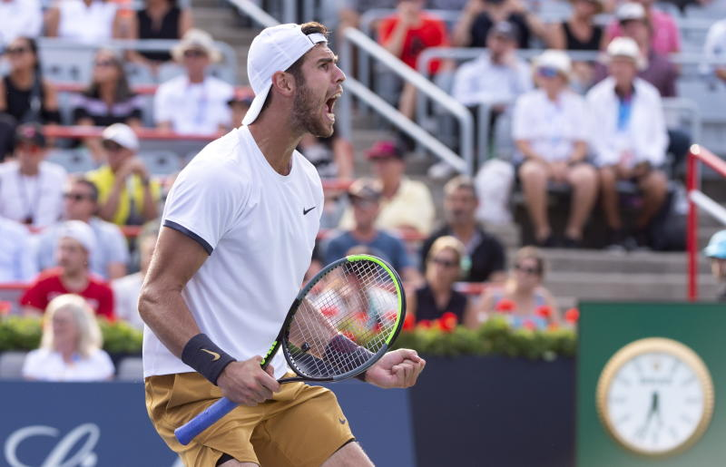 Karen Khachanov, of Russia, celebrates his victory over Felix Auger-Aliassime, of Canada, during the Rogers Cup men's tennis tournament Thursday, Aug. 8, 2019, in Montreal. (Paul Chiasson/The Canadian Press via AP)