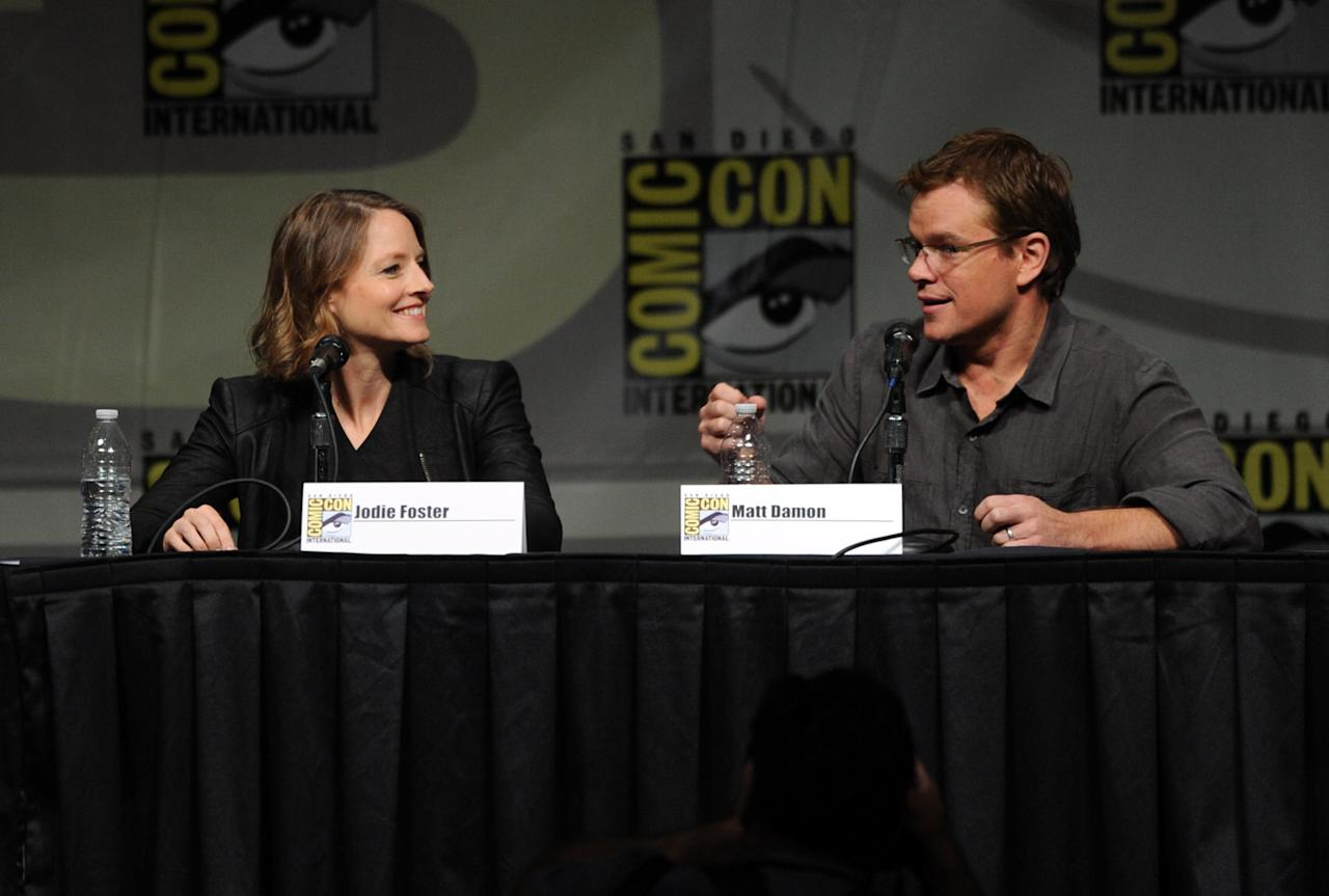"""SAN DIEGO, CA - JULY 13:  Actress Jodie Foster (L) and actor Matt Damon speak during Sony's """"Eylsium"""" panel during Comic-Con International 2012 at San Diego Convention Center on July 13, 2012 in San Diego, California.  (Photo by Kevin Winter/Getty Images)"""