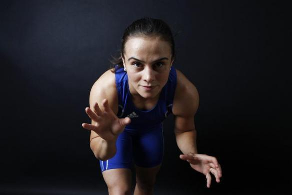 "Turkish wrestler and Olympic hopeful Elif Jale Yesilirmak, 26, poses for a picture in Ankara May 29, 2012. Yesilirmak sticks to a 3000 kcal-a-day diet. ""Instead of red meat I generally eat salmon. I believe fish is more healthy and nutritious. And also, lots of water. I drink a minimum of five liters of water every day,"" she says."