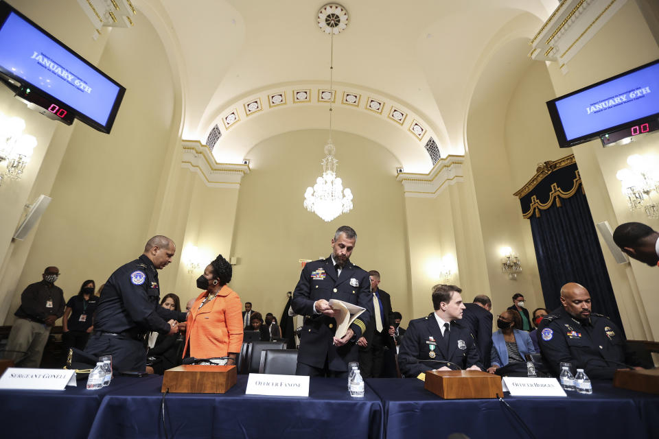 U.S. Capitol Police Sgt. Aquilino Gonell, left, shakes hands with Rep. Sheila Jackson-Lee, D-Texas, after a House select committee hearing on the Jan. 6 attack on Capitol Hill in Washington, Tuesday, July 27, 2021. From left, Gonell, Jackson-Lee, Washington Metropolitan Police Department officer Michael Fanone, Washington Metropolitan Police Department officer Daniel Hodges and U.S. Capitol Police Sgt. Harry Dunn. (Oliver Contreras/The New York Times via AP, Pool)