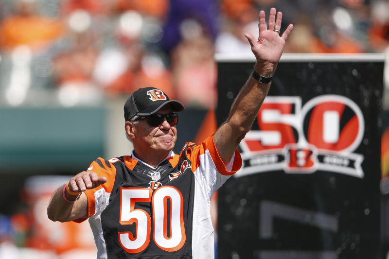 Former Cincinnati Bengals quarterback Ken Anderson waves to the crowd during a halftime 50th anniversary ceremony last season. (AP)