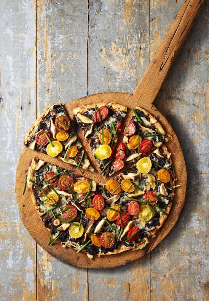 """<p>Think outside the plain cardboard box and load up a pie with good-for-you veggies. Just assemble and bake for a dinner that's ready in minutes.</p><p><em><a href=""""https://www.goodhousekeeping.com/food-recipes/a40393/roasted-tomato-chive-pizza-recipe/"""" rel=""""nofollow noopener"""" target=""""_blank"""" data-ylk=""""slk:Get the recipe for Roasted Tomato & Chive Pizza »"""" class=""""link rapid-noclick-resp"""">Get the recipe for Roasted Tomato & Chive Pizza »</a></em> </p>"""