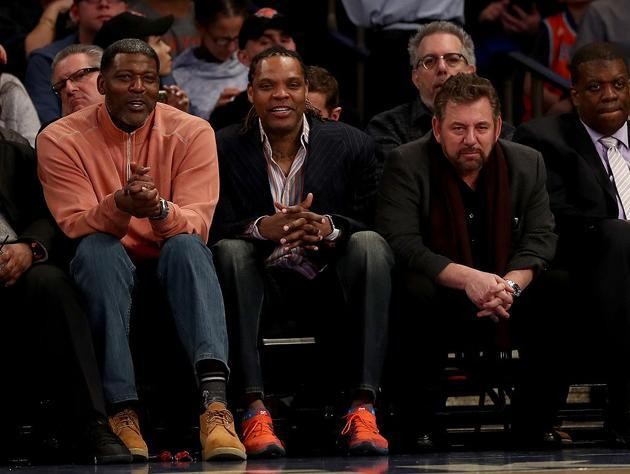 Good friends Larry Johnson and Latrell Sprewell joined James Dolan at Sunday's Knicks game. (Getty Images)