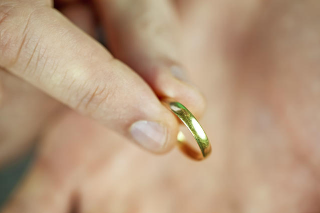 A man holding old wedding ring