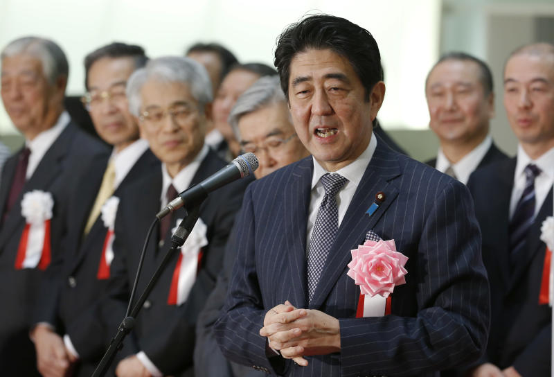 "Japanese Prime Minister Shinzo Abe speaks during a ceremony to wrap up the year's trading on the Tokyo Stock Exchange in Tokyo Monday, Dec. 30, 2013. ""Thanks to our efforts, the economy went from minus to positive,"" Abe said. With winter bonuses up by several hundred dollars on average, he said, ""You have to use that money, keep it moving."" Asian shares advanced Monday in light but upbeat pre-holiday trading, as Japan's Nikkei 225 index ended 2013 at its highest level in over six years. (AP Photo/Shizuo Kambayashi)"