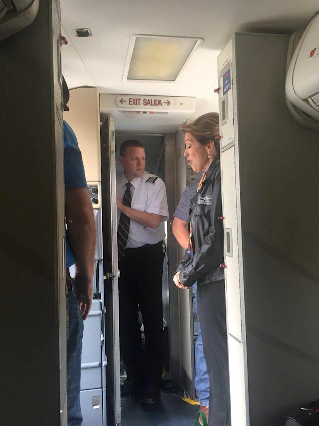 <p>Pilot Tammie Jo Schults and cabin crew are seen on Southwest Airlines flight 1380, in Philadelphia, Pa., April 17, 2018 in this picture obtained from social media. (Photo: Kristopher Johnson/via Reuters) </p>