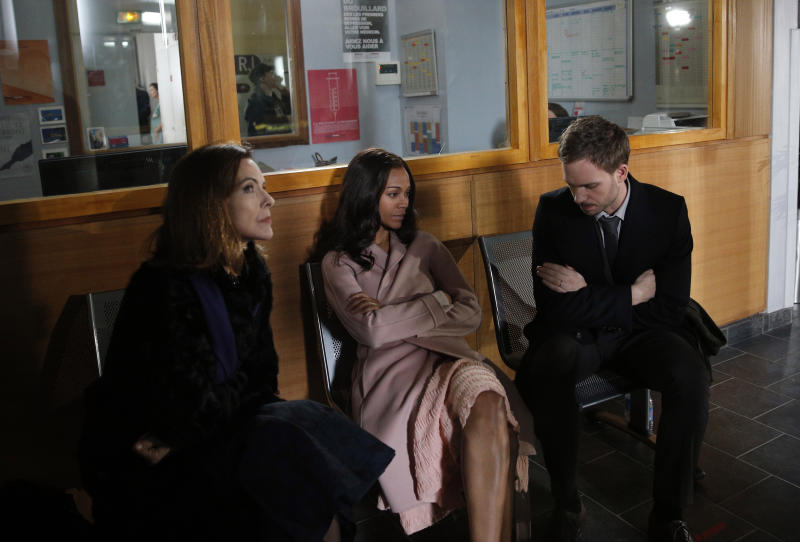 "Actors Zoe Saldana, center, Patrick J. Adams and French actress Carole Bouquet sit during the shooting of the adaptation of the psychological horror movie ""Rosemary's Baby"" by Polish director Agnieszka Holland in Issy-les-Moulineaux, outside Paris, Friday March 7, 2014. Saldana is Rosemary Woodhouse in the two-episode remake of Ira Levin's 1967 book, which director Roman Polanski also turned into an unforgettable 1968 film. The four-hour series directed by Agnieszka Holland also stars Patrick J. Adams, Jason Isaacs and Carole Bouquet. (AP Photo/Christophe Ena)"