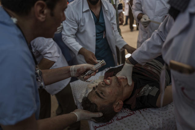 <p>A Palestinian man is treated at the field hospital after being injured by an Israeli sniper during the protest along the Eastern Gaza City's border with Israel on May 14, 2018. (Photo: Fabio Bucciarelli for Yahoo News) </p>