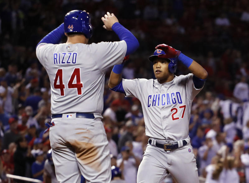 Cubs shortstop Addison Russell is congratulated by teammate Anthony Rizzo after hitting a three-run home run in the Cubs division-clinching win. (AP)