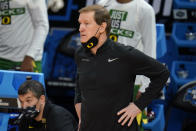 Oregon head coach Dana Altman watches from the bench during the first half of a Sweet 16 game against Southern California in the NCAA men's college basketball tournament at Bankers Life Fieldhouse, Sunday, March 28, 2021, in Indianapolis. (AP Photo/Jeff Roberson)
