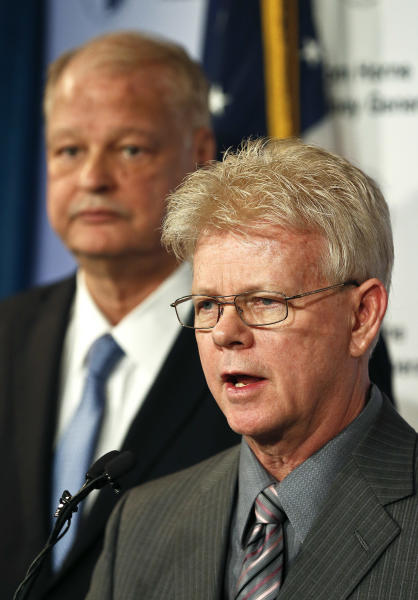 Mohave County Sheriff Tom Sheahan, right, speaks as Arizona Attorney General Tom Horne stands behind him at a news conference, Tuesday, Jan. 22, 2013, in Phoenix. Sheahan and Horne discuss how a variety of agencies helped Ruby Jessop and her six children leave a polygamist sect along the Utah-Arizona border. (AP Photo/Ross D. Franklin)