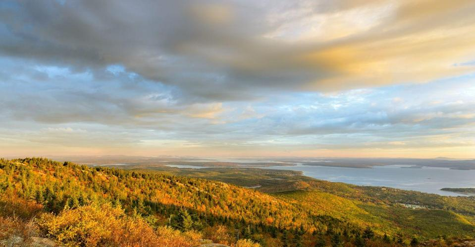 """<p>Bar Harbor and Acadia National Park are quintessential fall vacation spots. The best time to visit <a href=""""https://www.visitbarharbor.com/blog/visit-bar-harbor-4726/post/a-guide-to-the-7-best-foliage-photo-spots-in-bar-harbor-16371#:~:text=Peak%20foliage%20in%20the%20Bar,Harbor%20and%20Acadia%20National%20Park."""" rel=""""nofollow noopener"""" target=""""_blank"""" data-ylk=""""slk:ranges between mid-September and mid-October"""" class=""""link rapid-noclick-resp"""">ranges between mid-September and mid-October</a>, and one of the ideal ways to journey through its nature is on <a href=""""https://www.acadiabike.com/carriageroadsandroutes"""" rel=""""nofollow noopener"""" target=""""_blank"""" data-ylk=""""slk:carriage roads"""" class=""""link rapid-noclick-resp"""">carriage roads</a>, reserved especially for mountain bikers. Don't have a bike? No worries, you can easily <a href=""""https://www.acadiabike.com/bike-rentals"""" rel=""""nofollow noopener"""" target=""""_blank"""" data-ylk=""""slk:rent one"""" class=""""link rapid-noclick-resp"""">rent one</a>.</p>"""