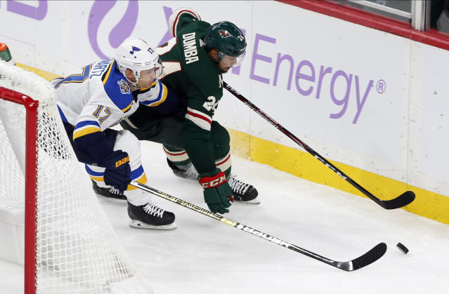 St. Louis Blues' Jaden Schwartz, left, and Minnesota Wild's Matt Dumba chase puck behind the net during the third period of an NHL hockey game Saturday, Nov. 2, 2019, in St. Paul, Minn. The Blues won 4-3 in overtime. (AP Photo/Jim Mone)