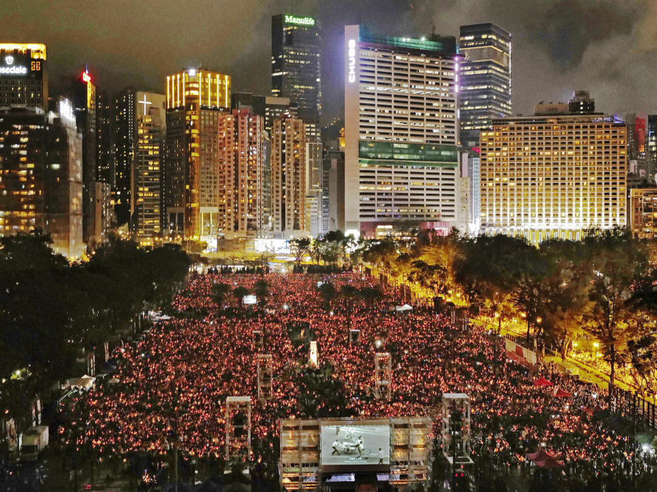 FILE - In this June 4, 2019, file photo, thousands of people attend a candlelight vigil in Hong Kong's Victoria Park to mark the anniversary of the military crackdown on a pro-democracy student movement in Beijing. (AP Photo/Vincent Yu, File)