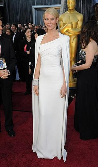 "<p class=""first""><b>Gwyneth Paltrow</b></p> <p>Gwyneth Paltrow was goddess divine at this year's Academy Awards in a  crisp white column of a dress designed by Tom Ford. Hailing Jackie O's  1961 inaugural ball gown (and matching cape coat) as the impetus for her  decision to wear the dress, it was indeed the floor-grazing cape that  set her statuesque look above and beyond the rest.</p>"