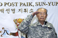 Former South Korean army Gen. Paik Sun-yup salutes during a ceremony at the New Mexico Range in Paju, South Korea on Aug. 29, 2013. Paik who was celebrated as a major war hero for leading troops in several battle victories against North Korean soldiers during the 1950-53 Korean War, has died. He was 99. (Yonhap via AP)