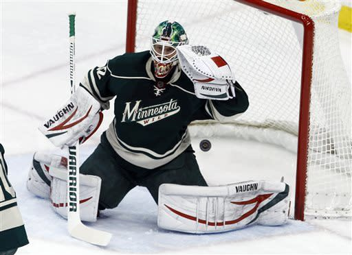 A shot by Edmonton Oilers left wing Taylor Hall, not pictured, gets past Minnesota Wild goalie Niklas Backstrom (32), of Finland, during the first period of an NHL hockey game in St. Paul, Minn., Friday, April 26, 2013. (AP Photo/Ann Heisenfelt)
