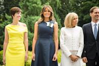 For a meeting with state officials, including the French President and his wife, Melania decided on a navy blue dress by Calvin Klein which featured detail at the neck. [Photo: Rex]