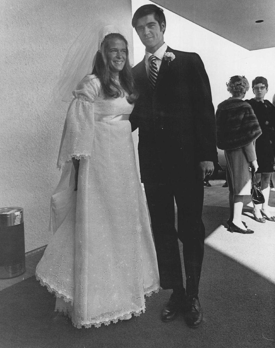 <p>Bell-style sleeves were another big trend for '70s brides, creating a dramatic silhouette. Here, we see another trend of gowns of this era: empire waists. </p>