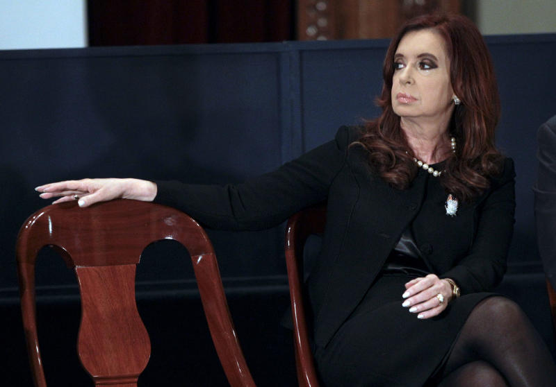 "FILE -  In this Aug. 2, 2012 file photo, Argentina's President Cristina Fernandez attends an event marking an anniversary of the Stock Exchange in Buenos Aires, Argentina. Argentina's government on Saturday, Sept. 22, 2012 gave one of its leading media critics, Grupo Clarin, a Dec. 7 deadline to sell off most of its broadcast stations, saying ""7D"" will stand for ""diversity and democracy"" as the day when media monopolies will no longer be able to put themselves above the law. (AP Photo/ Eduardo Di Baia, File)"