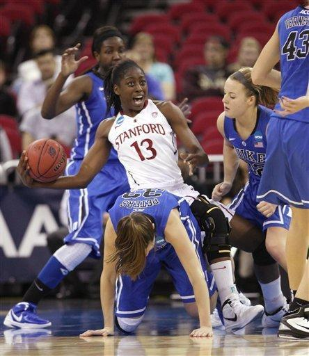 Stanford's Chiney Ogwumike, center, is fouled as she falls over the back of Duke's Haley Peters, foreground, during the first half of an NCAA women's tournament regional final college basketball game, Monday, March 26, 2012, in Fresno, Calif.(AP Photo/Rich Pedroncelli)