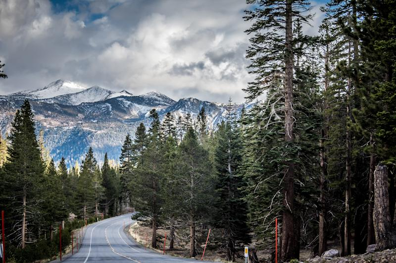 Looking down the road California State Route 203 in Mammoth Lakes, with the Sierra Nevada Mountains in the distance