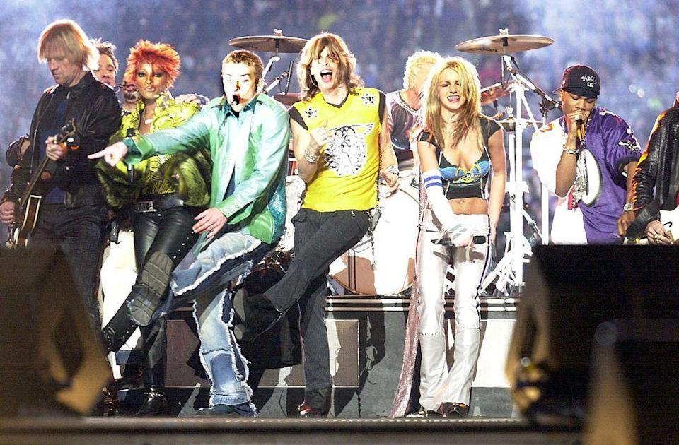<p>Blige and Nelly also joined the show. Blige wore a yellow snakeprint shirt and leather bootleg trousers. </p>