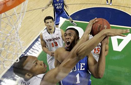 Jabari Parker (1) tries to shoot over Virginia's Darion Atkins during the ACC tournament. (AP)