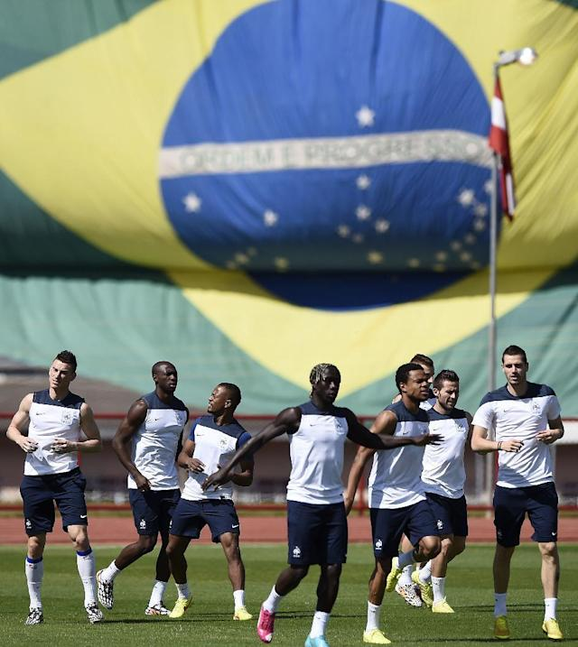 France's players run during a training session in Brasilia on June 25, 2014, on the eve of their FIFA 2014 World Cup Round of 16 football match against Nigeria (AFP Photo/Franck Fife)