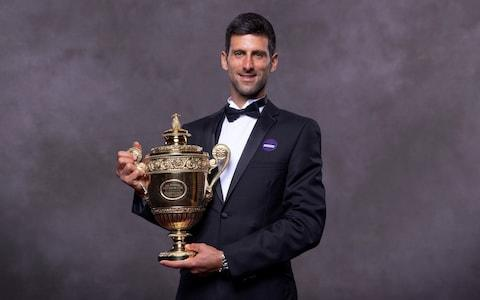<span>Novak Djokovic during his official Wimbledon winner photoshoot</span> <span>Credit: GETTY IMAGES </span>
