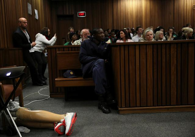 A Police officer looks on as Paralympic gold medalist Oscar Pistorius's prosthetic legs are seen during the third day of the resentencing hearing for the 2013 murder of his girlfriend Reeva Steenkamp, at Pretoria High Court, South Africa June 15, 2016. REUTERS/Siphiwe Sibeko