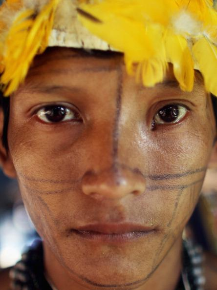 An indigenous man poses before the start of the Xingu  23 event that gathers resisters of the Belo Monte dam project in the Amazon basin on June 13, 2012 in Santo Antonio, near Altamira, Brazil. Santo Antonio is adjacent to where the Belo Monte dam complex is under construction and the entire community will be expropriated for the construction. Around 60 families originally lived in Santo Antonio but now only about ten families remain.  Mario Tama/Getty Images